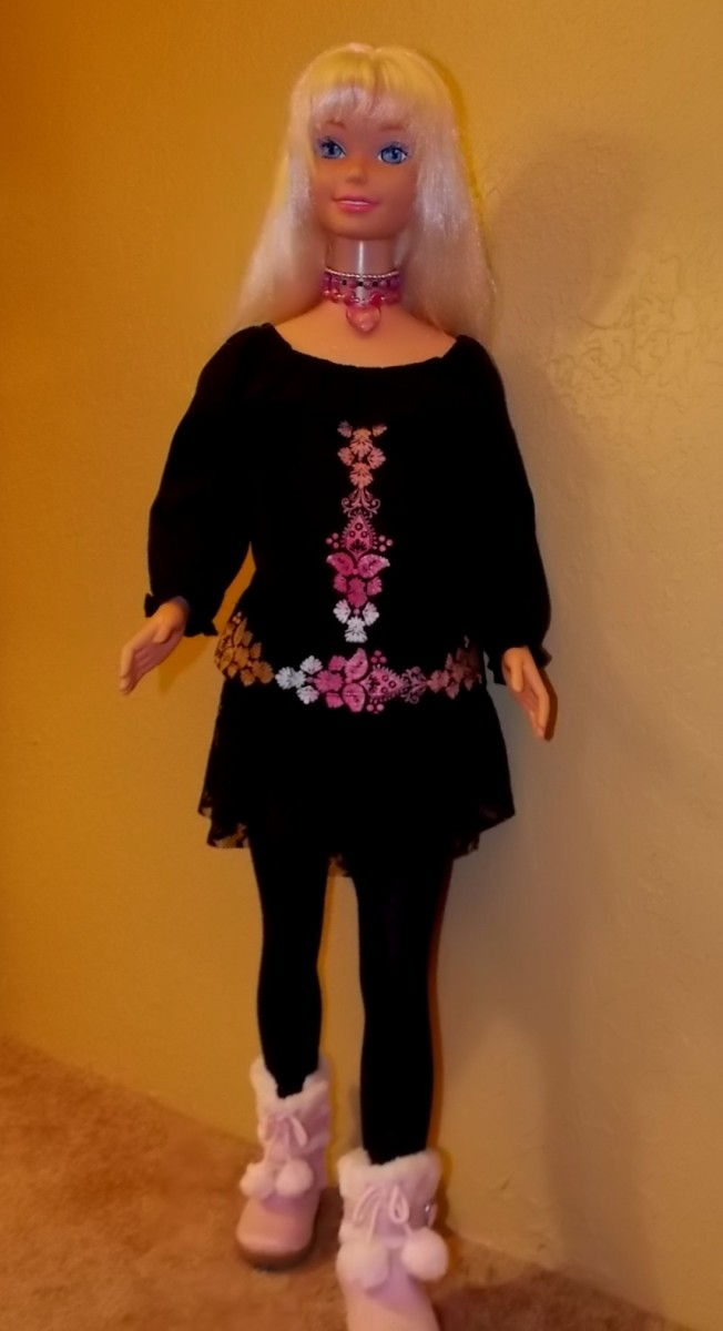 Barbie doll wearing black outfit with pink Uggs