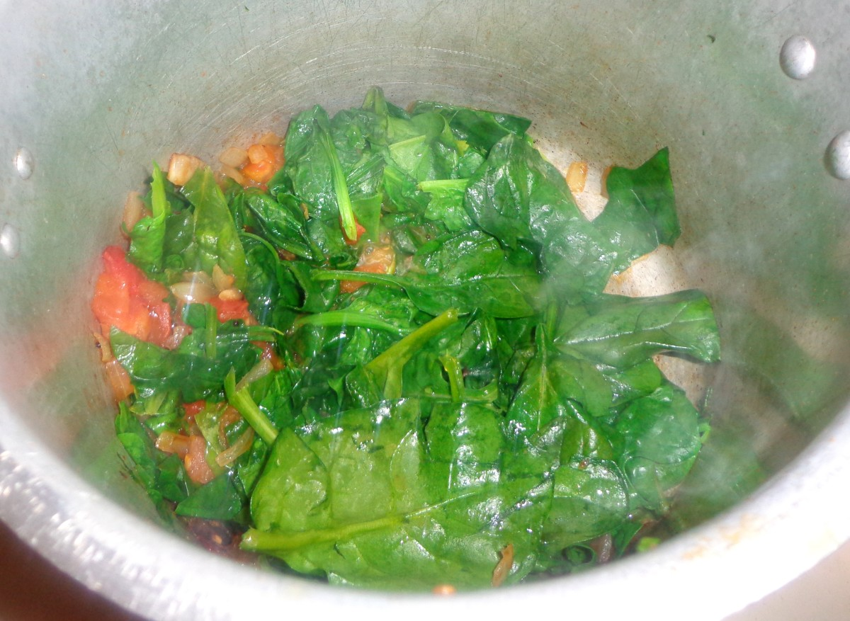Spinach is added to tomato & other ingredients