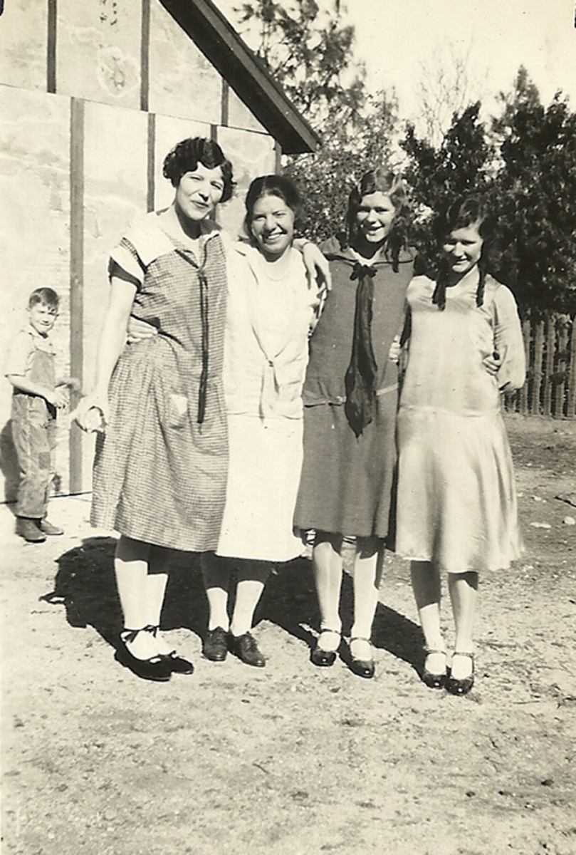 My grandmother (right), her sister Lois next to her and two family friends, Thanksgiving 1927.  Even then they had photo bombers.