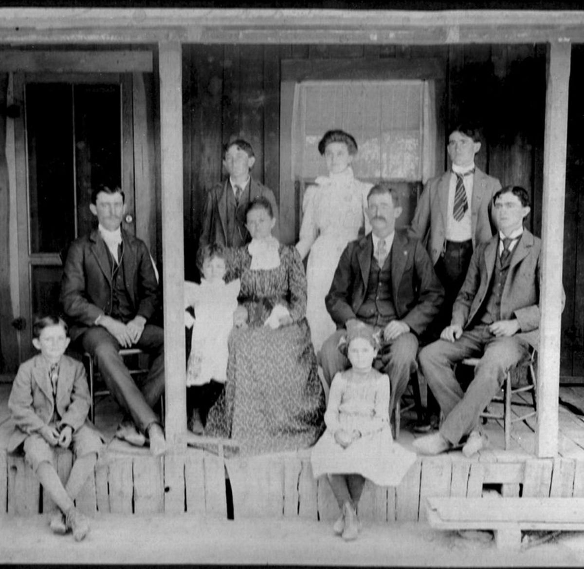 Francis Quintilla and Benjamin Franklin Bolllinger are seated center surrounded by their children, circa 1902.