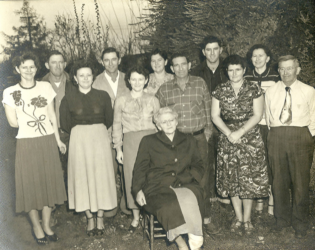 The Bollinger siblings and mother,Amy Bollinger, sitting.