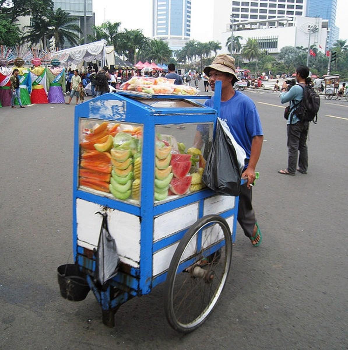 Fresh fruit vendor, Jakarta, Indonesia; example of street food cart.