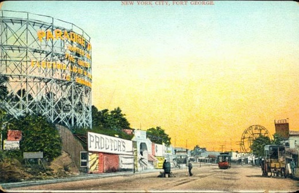 Paradise Park ( on the left hand side of this postcard ) at sunset. One of many ferris wheels can be seen in the distance.