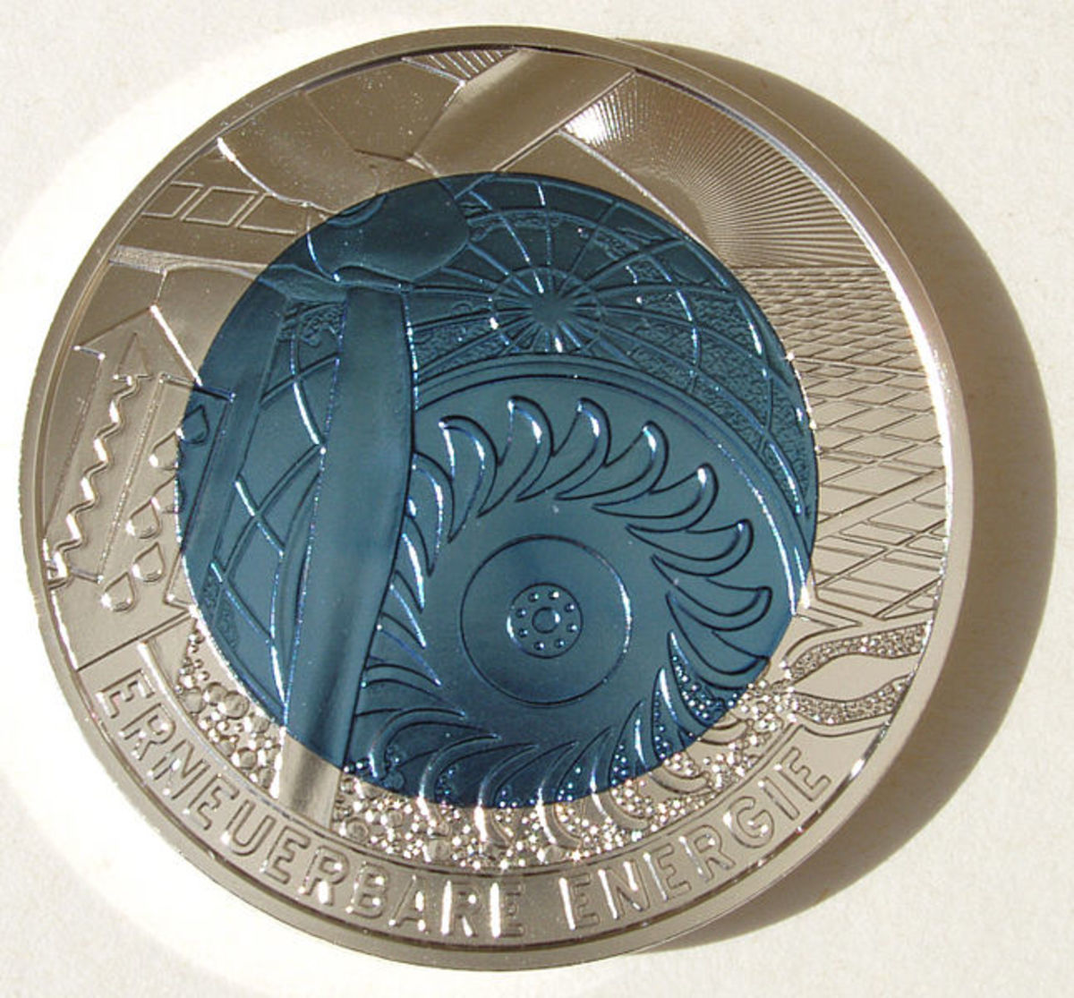 "An Austrian 25-Euro ""Renewable Energy"" coin.  Photo by NobbiP, courtesy Wikimedia Commons."