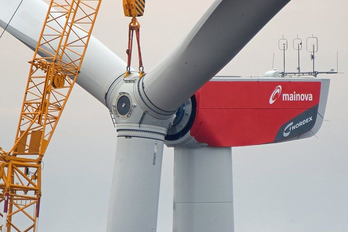 Wind turbine rotor installation.  Photo by Mainova AG, courtesy Wikimedia Commons.