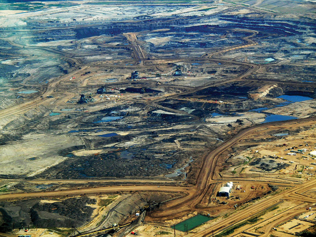 Alberta tar sands. Oil and tar sands are strip mined or extracted in the open pit method.