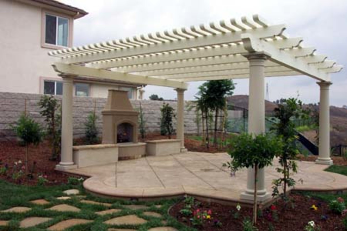 patio room with arbor and stone fireplace with matching patio