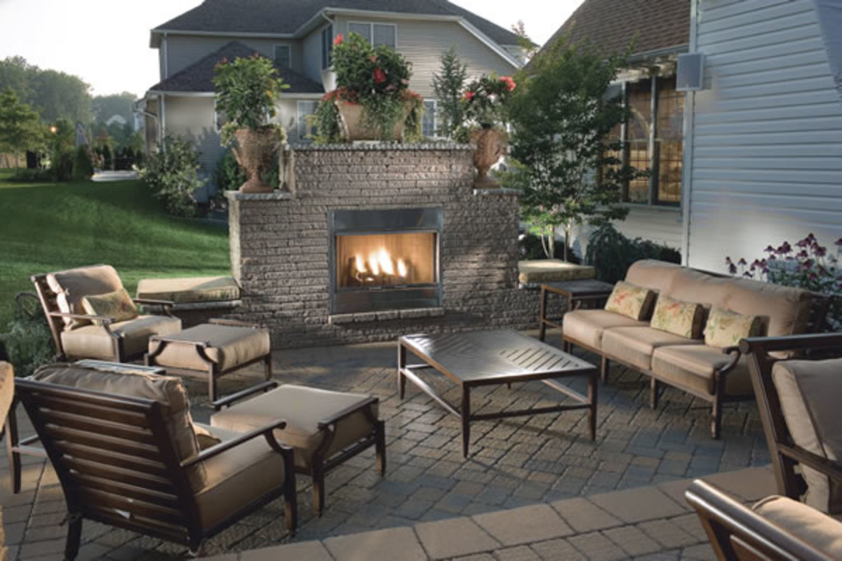 brick patio with stone fire place and patio set with cushions