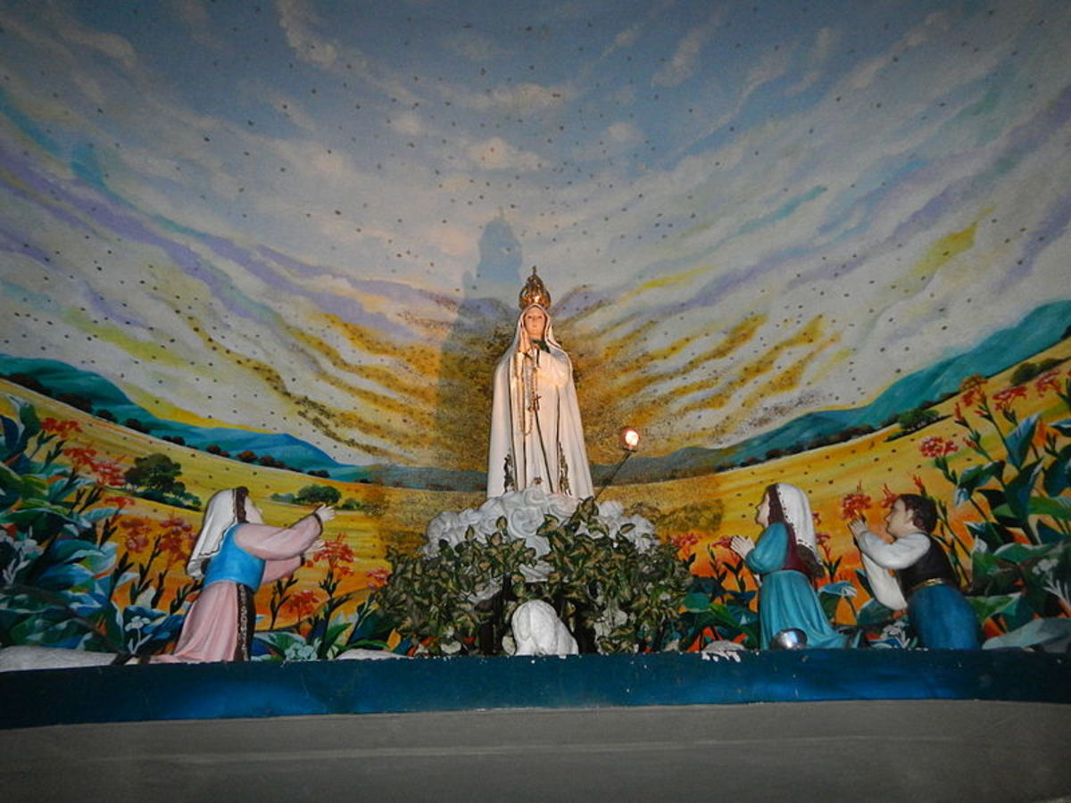 Statues depicting the Blessed Virgin Mary appearing to the three children of Fatima. These images are at the National Shrine of Our Lady of Fatima located in Marulas, Valenzuela City, Philippines.