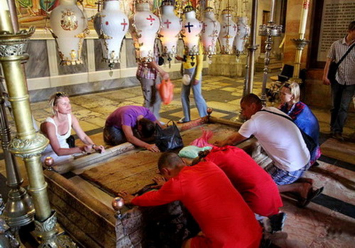 Stone of Anointing which tradition claims to be the spot where Jesus' body was prepared for burial by Nicodemus and Joseph of Arimathea. The stone greets you to Sepulcher at the entrance.  (Station 13)