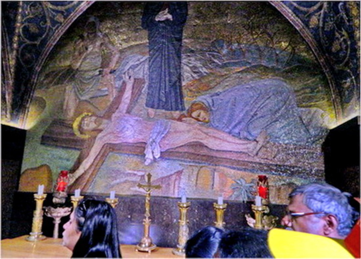 Jesus is nailed to the cross while His mother watches on. Upon entering the steps to Golgotha, first you see the Altar of nails ( Station 11)