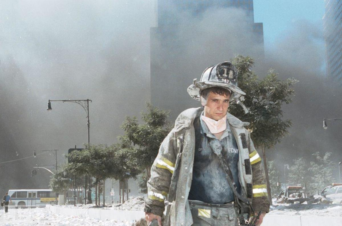 Finally done for that day, this firefighter also has only a painter's mask for protection.