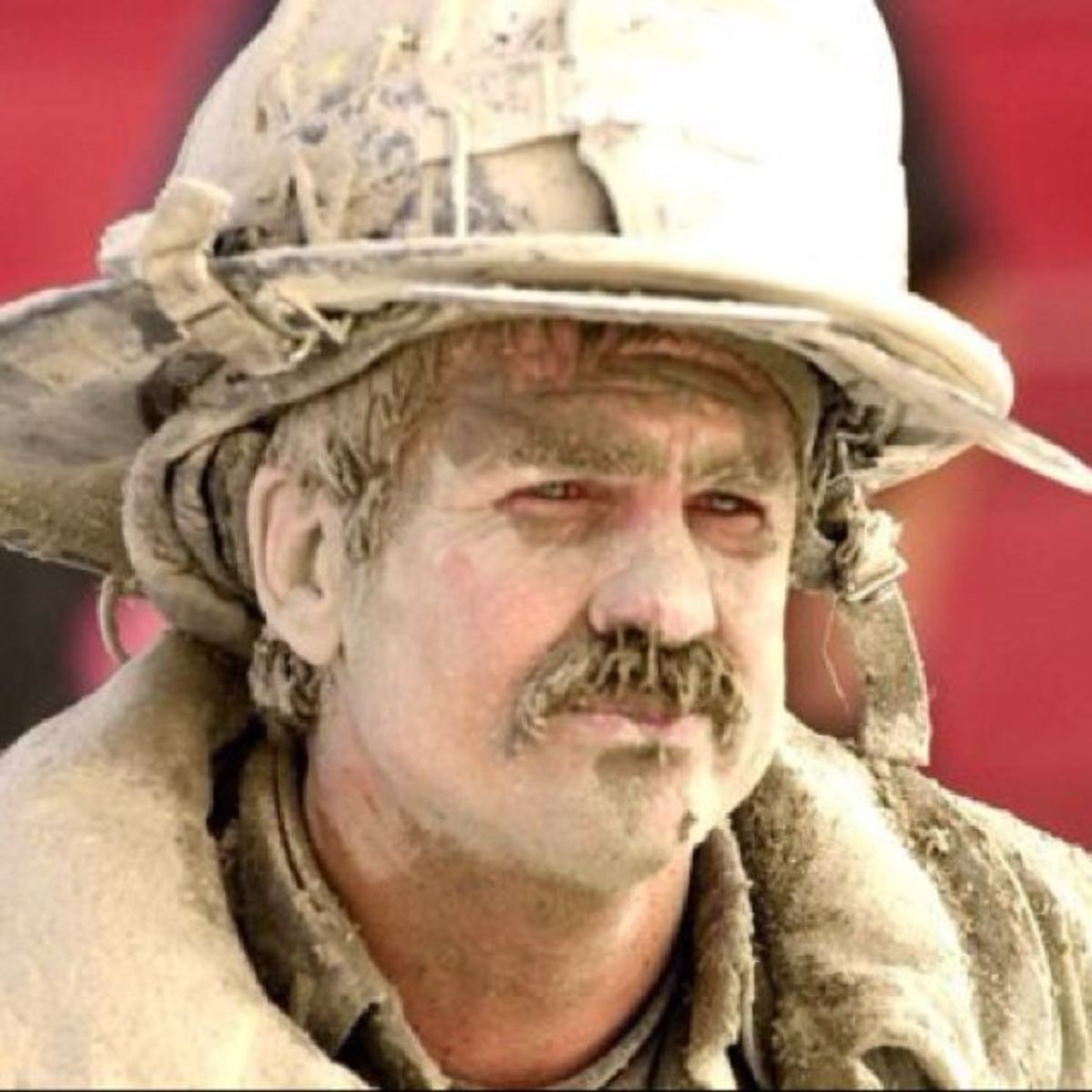 Hero:  Dust covered firefighter - notice his nose and moustache covered in dust. It looks like no mask was in use, hence no respiratory protection.
