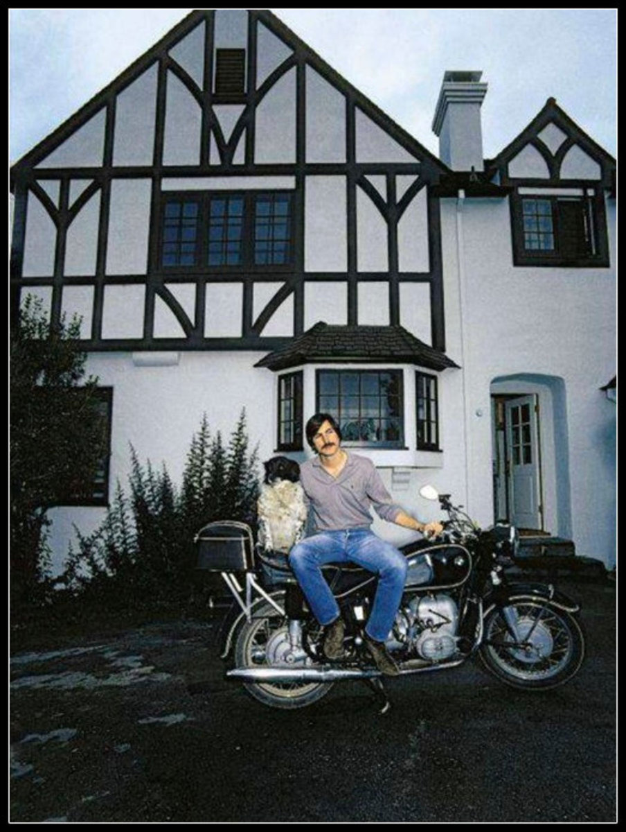 Steve Jobs in front of his new home in Los Altos, CA @ 1980. A home that would remain unfurnished for many years. It is now abandoned in danger of demolition