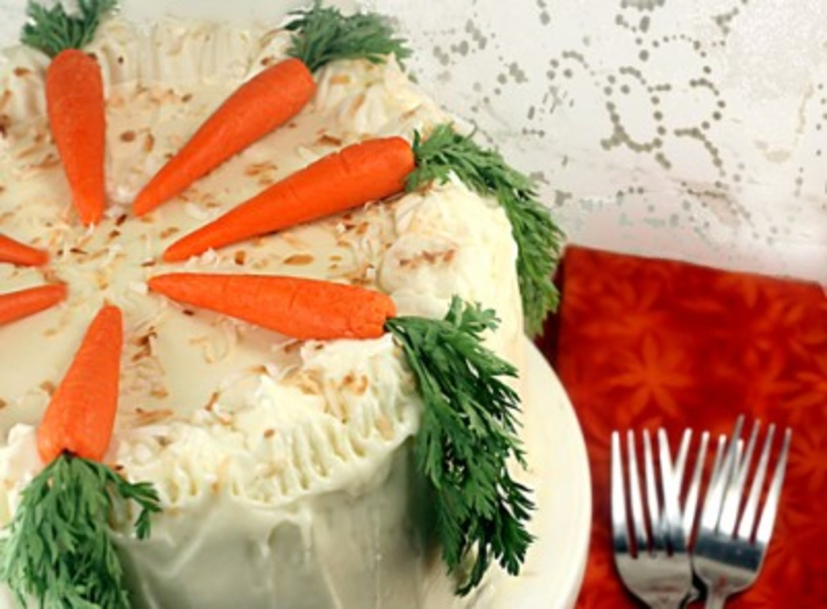 Natural approach with either marzipan carrots and real carrot fronds or real carrots.