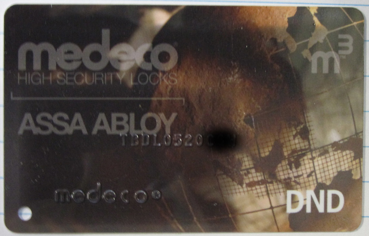 Medeco restricted key authorization card, number partially masked.   No card, no key.