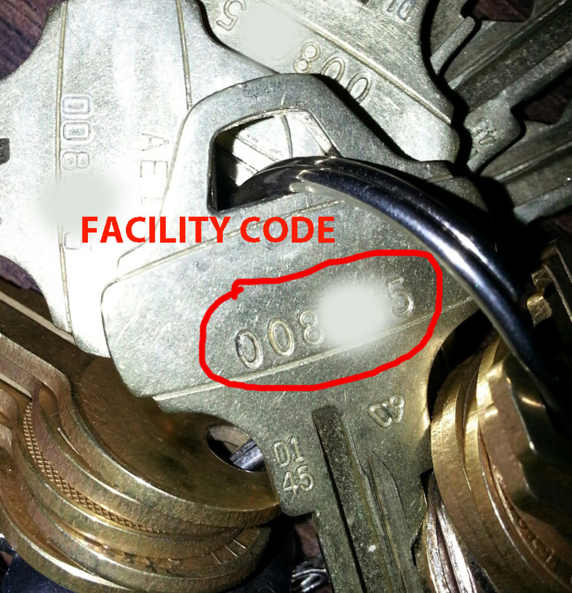 "Schlage Everest ""D Family"" Restricted Key, facility code number partially masked."