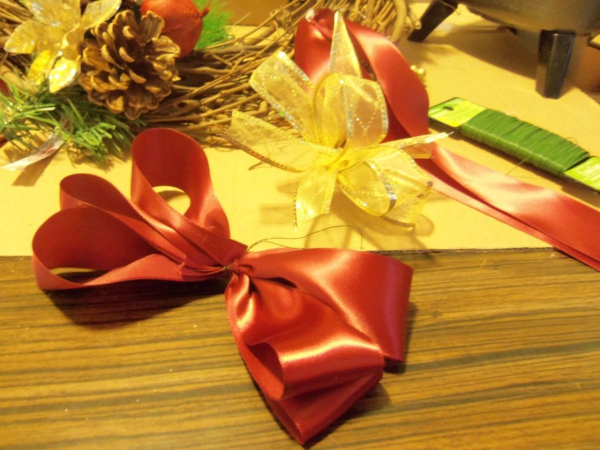 "Make a satin bow that will be a little larger than the gold one. Make bow using 30"" of ribbon and wire the center.  See video if needed."