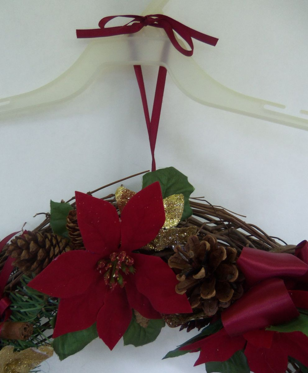 Top of wreath ribbon and hanging bow.