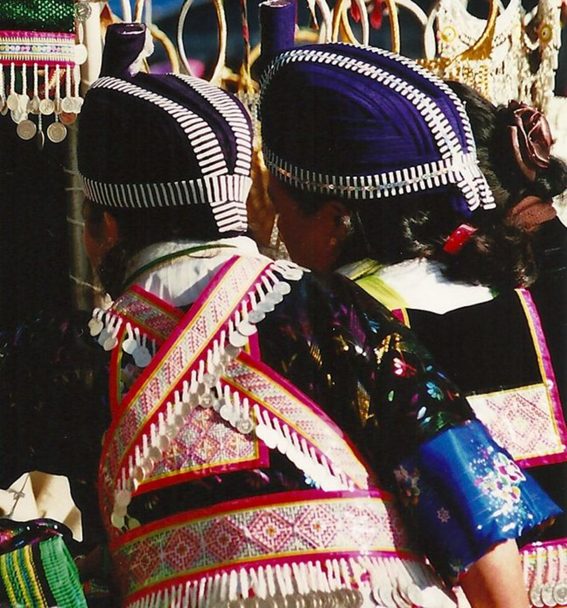 Another photo taken at the Hmong New Year celebration showing the stitching on the women's belts.