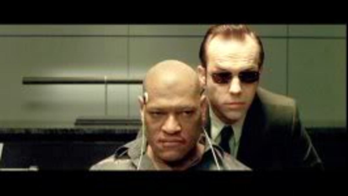 At (7m1s) Morpheus is revealed to be an international terrorist and shortly thereafter mysterious news appears in Arabic for a bare second.