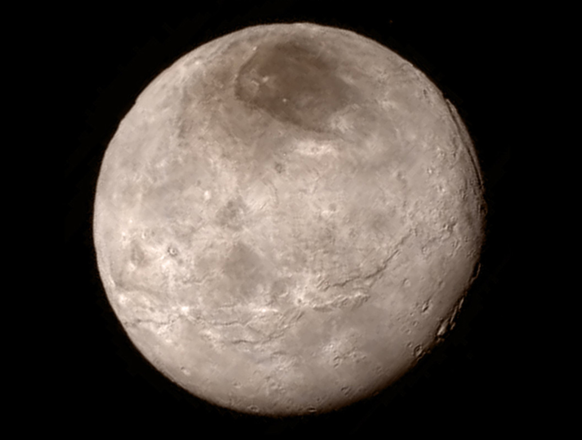 "July 13 photo of Charon shows a younger, more varied landscape than we could've hoped for, with canyons many miles deep! The dark patch at the top is called ""MORDOR."""