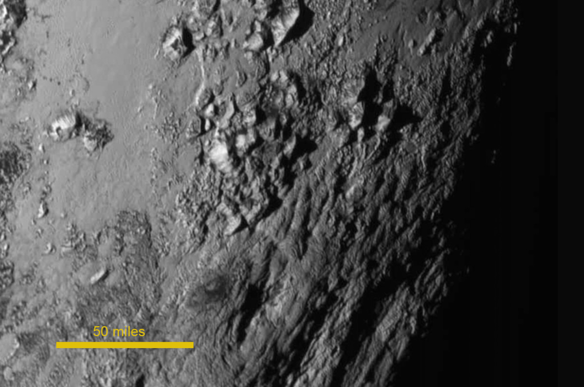 """Norgay Mountains, the zoom above. Named after Sherpa who helped Hillary climb Everest. (The """"heart"""" has been formally named Tombaugh Regio, after Pluto's discoverer.)"""