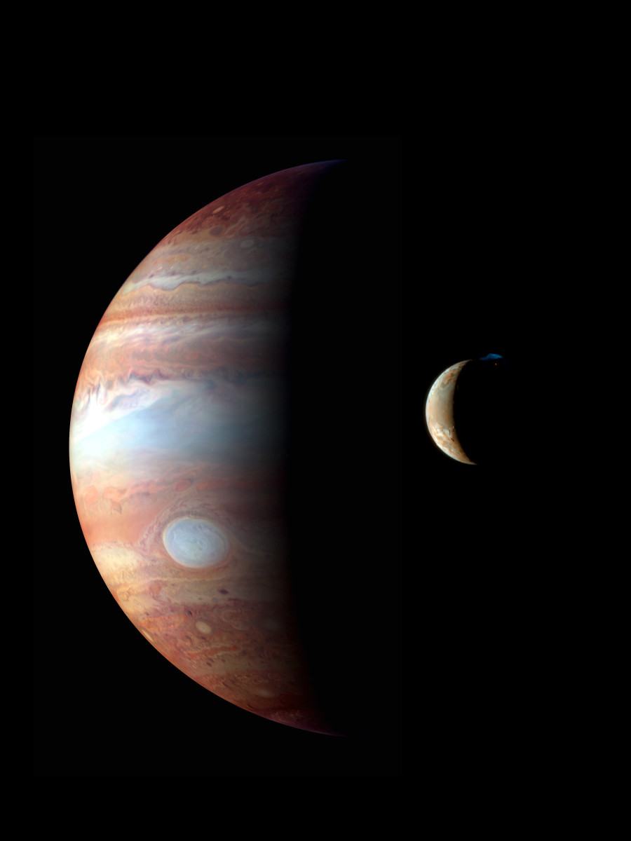 In infrared, the Great Red Spot is white, and the volcanoes of Io erupt in ghostly blue.