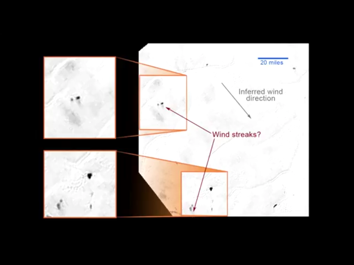 Wind deposits on the backsides of obstacles, or... plume deposits from a geyser? VERY speculative; we don't know yet. (Screengrab from streaming video, and the original image had JPG compression artifacts, so take details with a grain of salt)