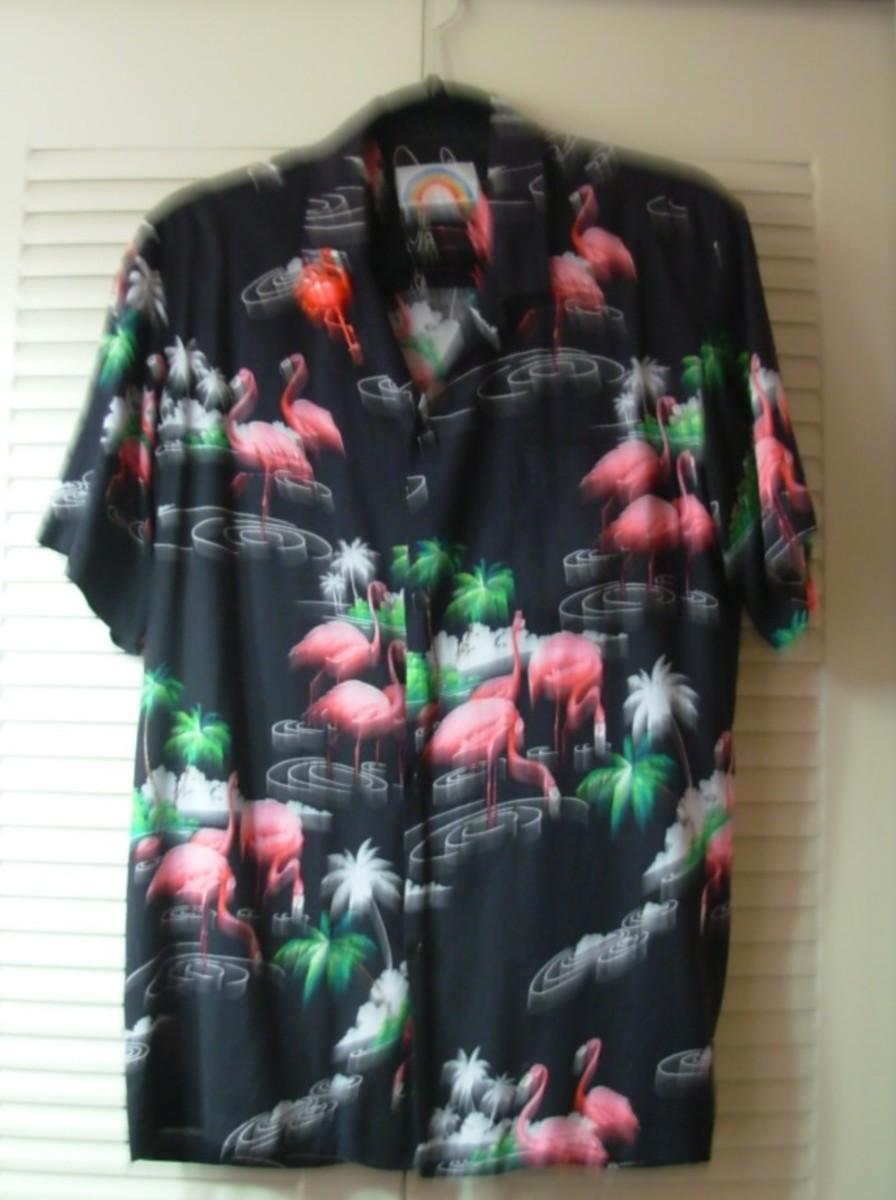 a flamingo shirt with a flamingo pin.