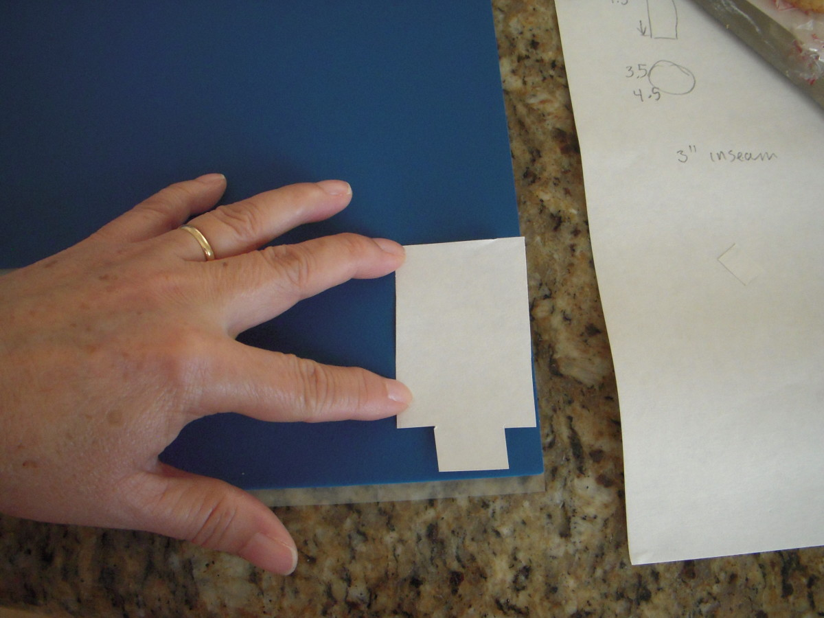 Place pattern pieces onto Sugar Sheets and cut out with scissors. You will cut pants and suspenders out of blue Sugar Sheet, and headband out of black Sugar Sheet.