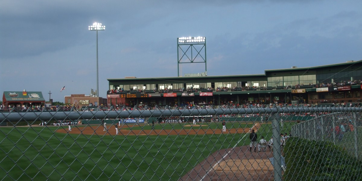 One fan's view on the lawn behind the outfield area at Clipper Stadium.