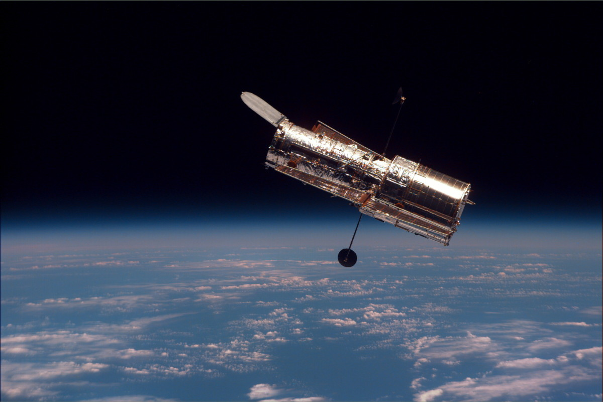 The Hubble Space Telescope in orbit around the Earth.