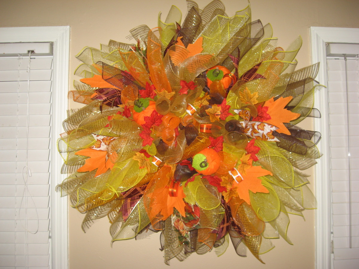 To this spiral fall wreath, I added ribbons, pumpkins, and autumn leaves.