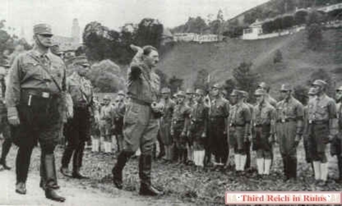Adolf Hitler reviews a SA (Sturmabteilung) unit in Berchtesgaden in July 1932.
