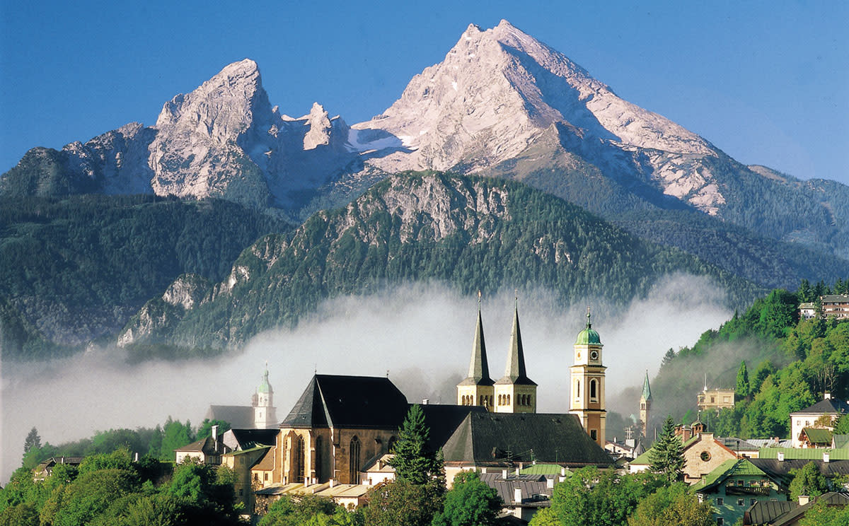Tops of the city of Berchtesgaden, Germany with Alp Watzmann behind.
