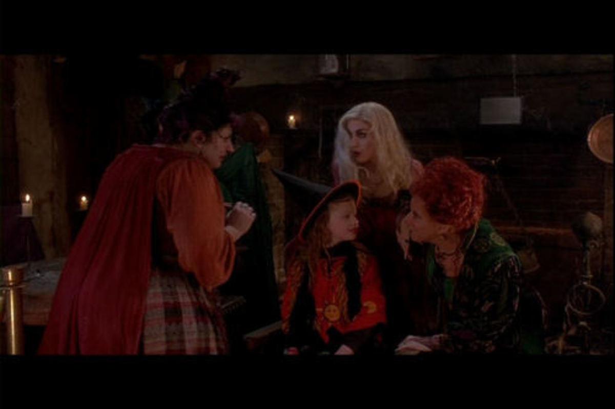The Sanderson Sisters (Kathy Najimy, Sarah Jessica Parker and Bette Midler) quiz Dani (Thora Birch)