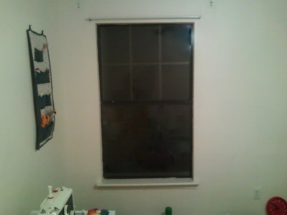 The bare window in my craft room that needs a curtain.