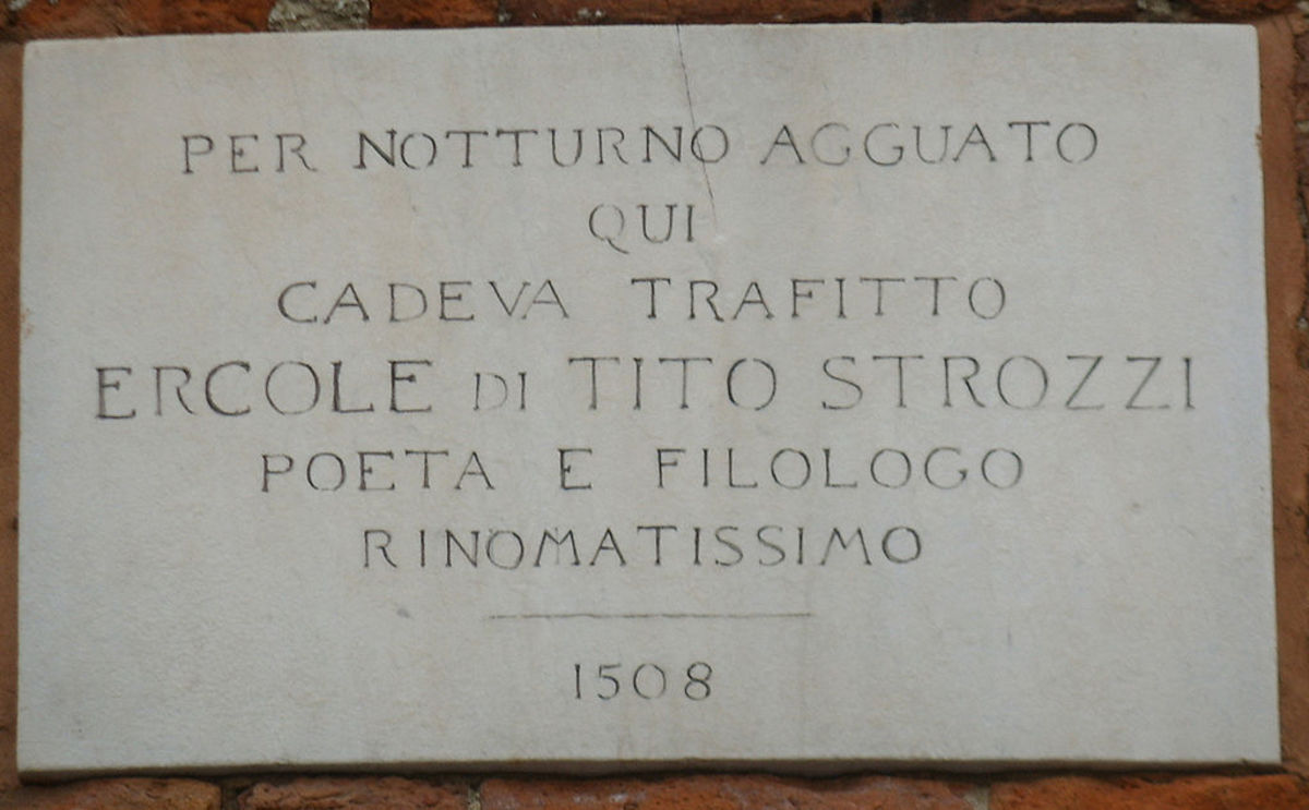 The stone commemorating Ercole Strozzi murder, on the wall of Casa Romei in Ferrara