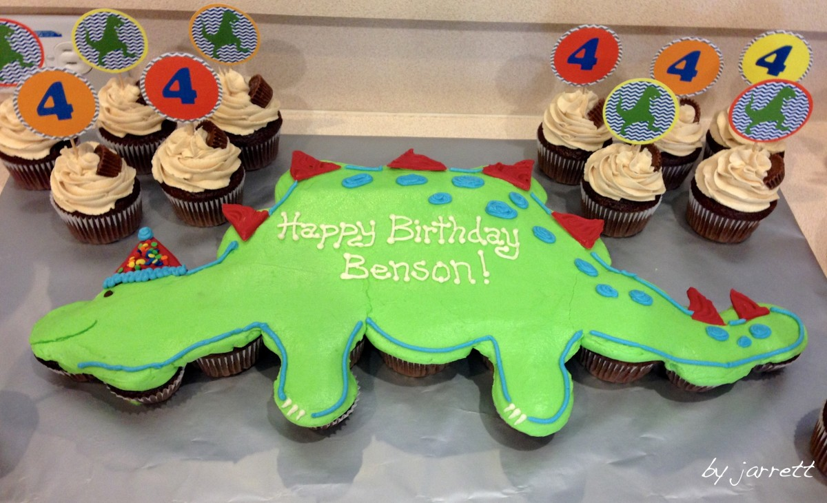 Multiple cupcakes used to create a fun kid's dinosaur birthday cake.