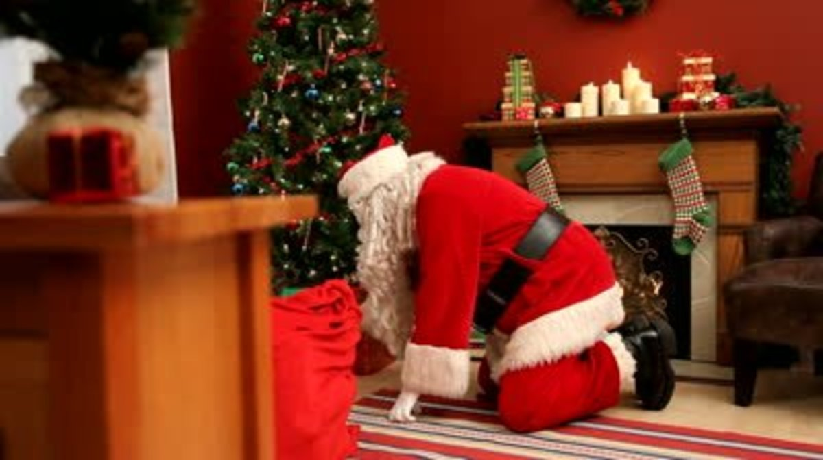 Santa putting gifts under the tree