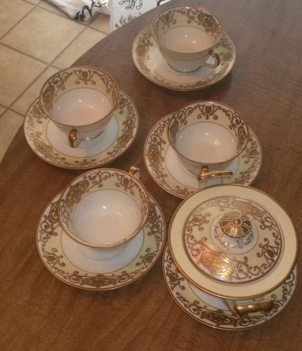 "A gorgeous set of demitasse tea cups with saucers and a sugar bowl in the Christmas Ball pattern #175. All items are stamped ""made in occupied Japan""."