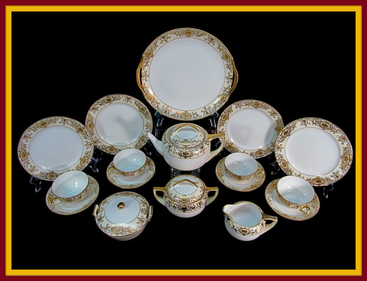 The Noritake Christmas Ball #175, China pattern, Made in Japan. Heavy gilt gold decoration really makes this a stunning set.