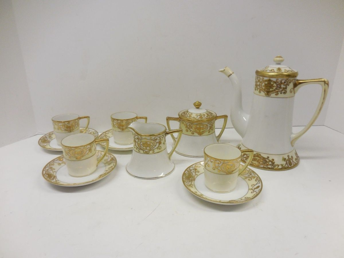 "NORITAKE CHRISTMAS BALL 13 PIECE DEMITASSE SET.  The coffee pot stands 6.5"" high and 6.5"" wide with some gold loss on the handle.  The creamer is 2.5"" high and 3"" wide.  The sugar bowl is 3.5"" high and 4"" wide.  The saucers are 4"" in diameter and the"