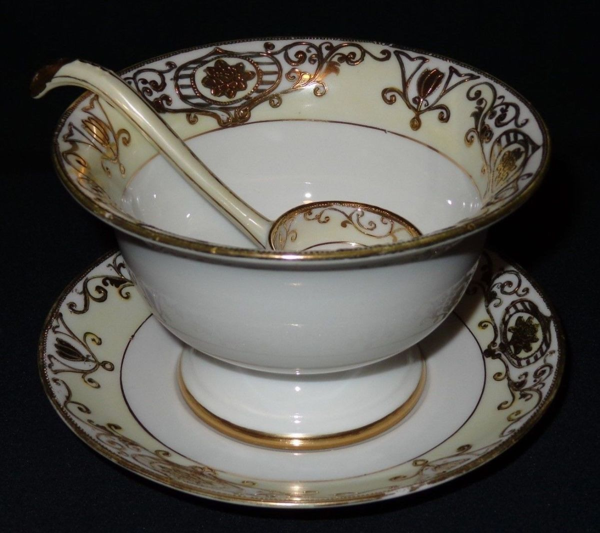 This is a three-piece set of a mayonnaise server with an under-plate and a ladle.