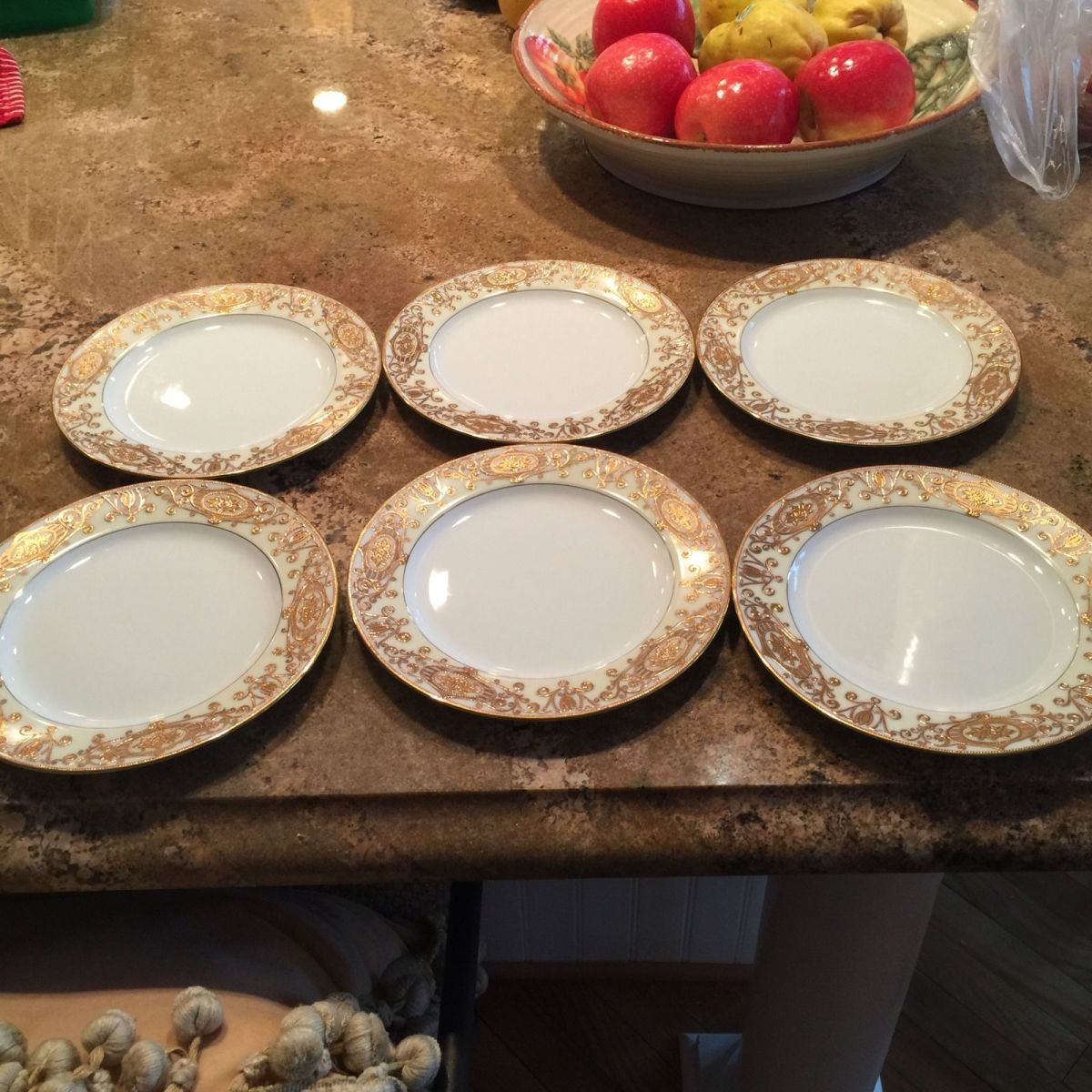 Six  salad or dessert plates - For the age they are excellent condition, the gold looks nice and shiny. The plates are a tad over 7 1/2 inches.