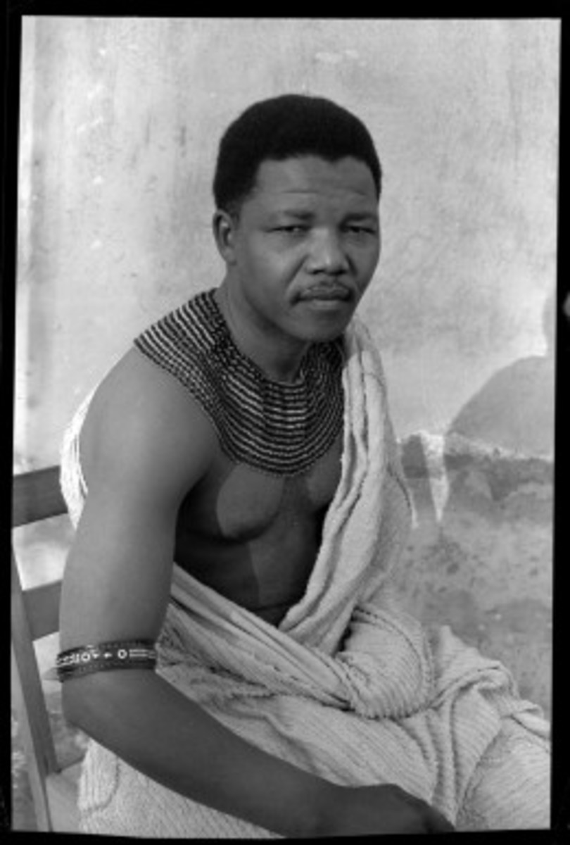 "Eli Weinberg, Nelson Mandela portrait wearing traditional beads and a bedspread. Hiding out from the police during his period as the ""black pimpernel,"" 1961. Courtesy of IDAFSA"