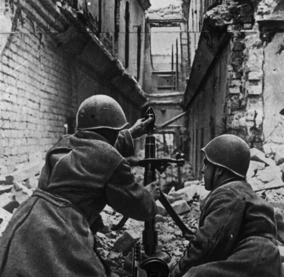 Soviet mortar crew in action in the rubble of Stalingrad.