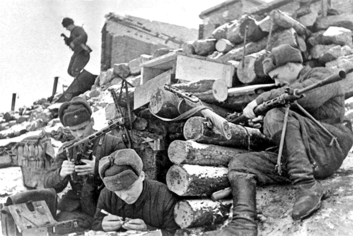 Soviet troops taking time to clean their weapons during a lull in the fighting at Stalingrad.