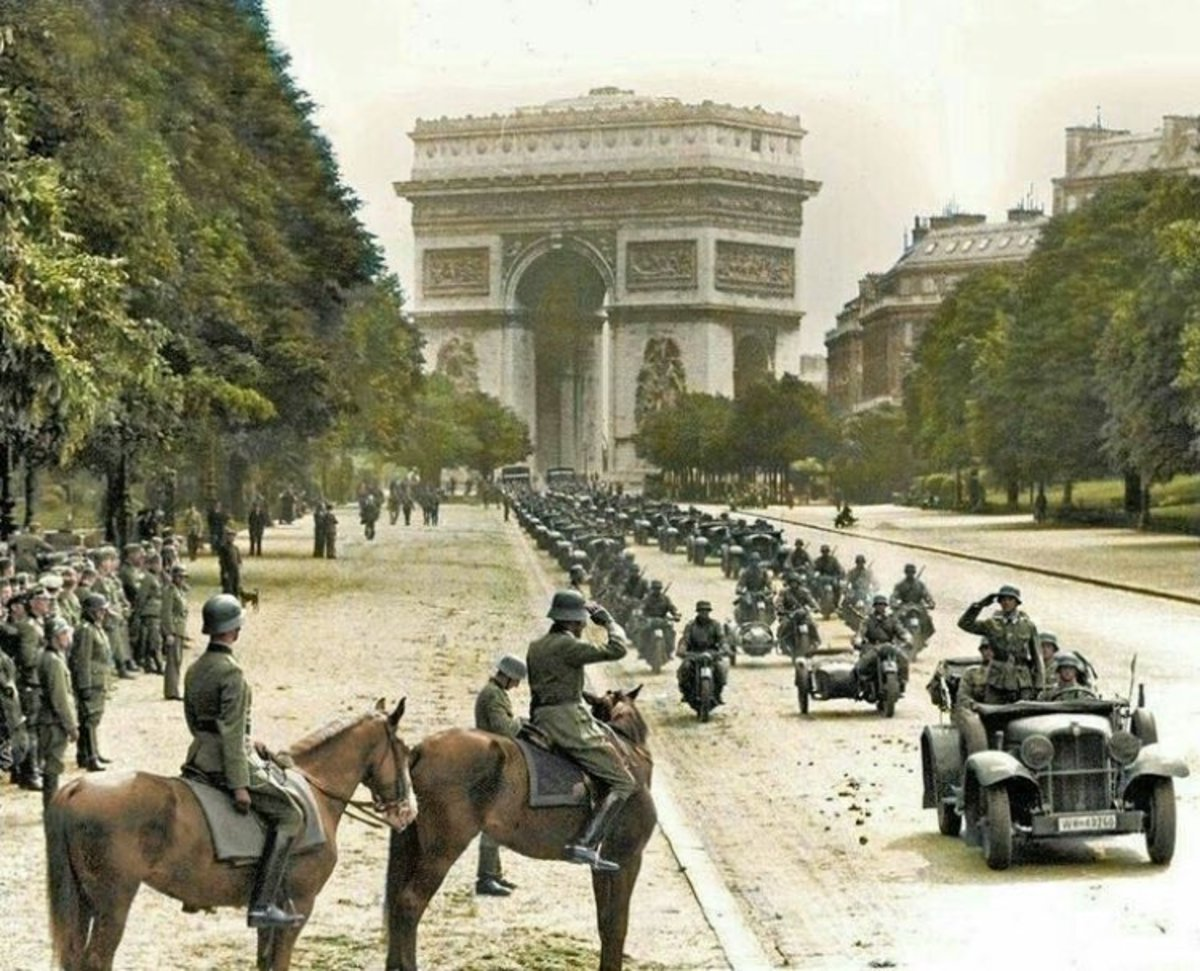 German soldiers marching through the arch de triumph in the summer of 1940 after the defeat of France.